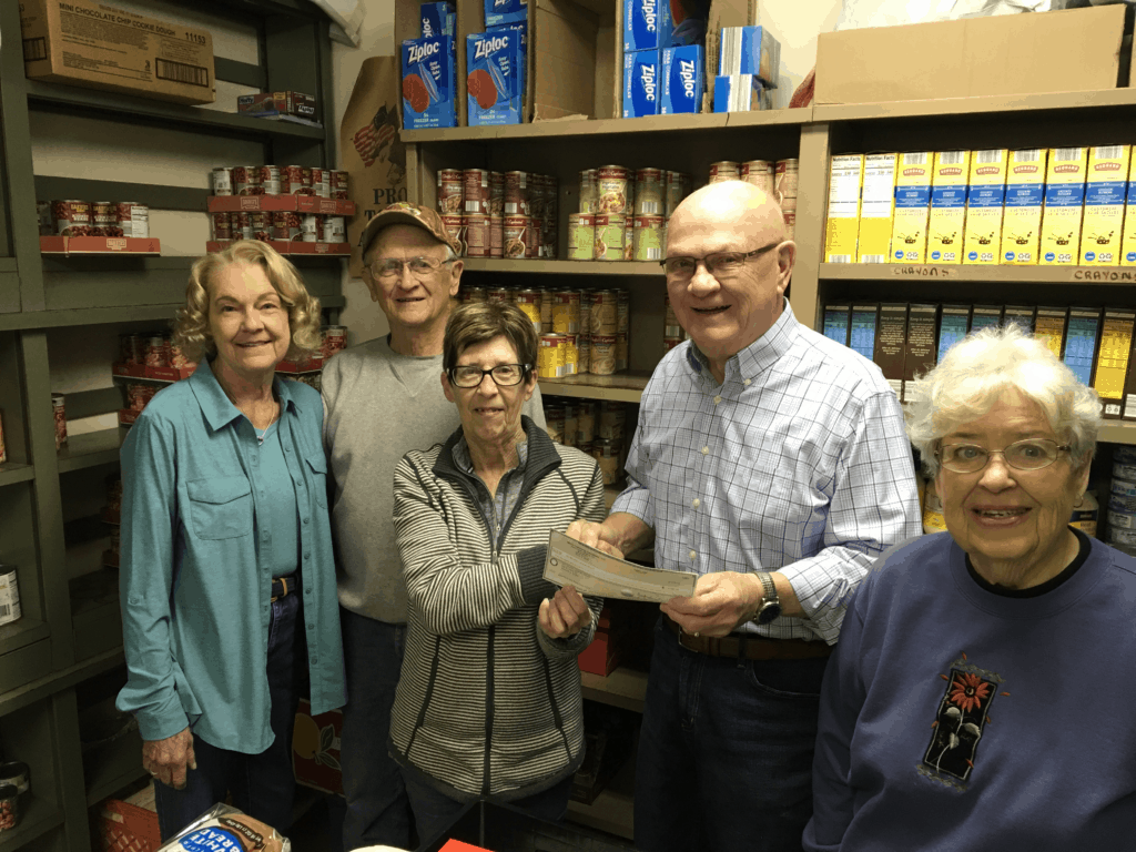 Volunteers at the Seneca Food Pantry accept a grant check for Davis Fund chair Fran Kasten