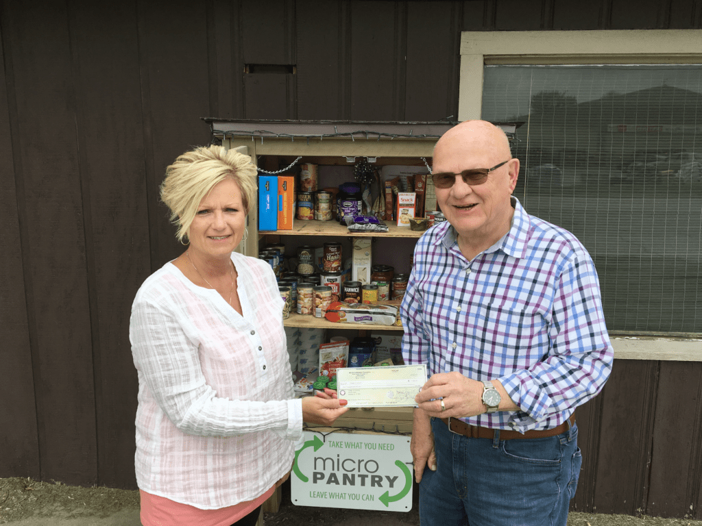 Kathy Haralson accepts a grant check for the Seneca Micro Food Pantry
